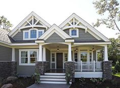 Gray Home with White Trim  Love the gray siding, columns, stone and the clap board shingles at top