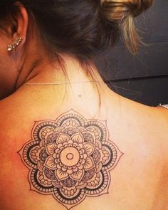 Mandala tattoo.... This, but smaller, white, and on the nape of my neck instead of on my back http://tattoo-ideas.us
