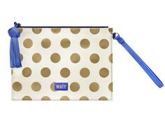 add some pop to her look with this metallic polka dotted clutch
