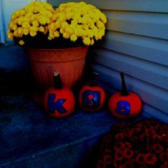 Initial halloween pumpkins. Scrapbook paper, spray adhesive, and modge podge. Love it!!!!