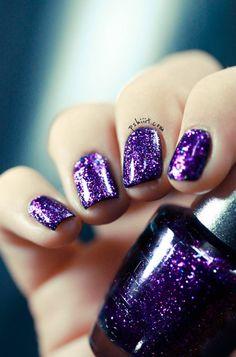 Purple glitter nails.