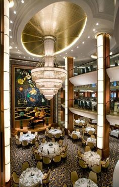 Main dining room on Oasis of the Seas. http://www.premiercustomtravel.com/cruises/royalcaribbean.html #Travel #Cruising #RoyalCaribbean #OasisOfTheSeas #BigShip #DiningRoom