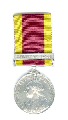 Obverse (front) side of the China Relief Expeditionary Medal 1900, with Relief of Pekin clasp awarded to F.J. White, Orderly, assigned onboard the H.M.S. Barfleur, who was wounded at Tientsin, 13 July 1900. White sustained a bullet wound right achilles tendon.