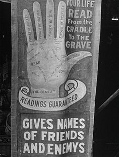 1938 Sign for READINGS GUARANTEED/ YOUR LIFE READ FROM THE CRADLE TO THE GRAVE w. hand chart drawing, advertising sideshow palm reader at carnival in the Greenbrier Valley Fair. (Photo by Alfred Eisenstaedt/Pix Inc./Time Life Pictures/Getty Images) palm, hand