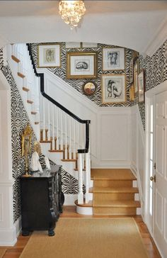 Gorgeous wainscoting, wallpaper, and gallery wall!
