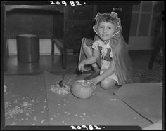 Joseph Janney Steinmetz, Untitled (child with hooded costume carving pumpkin on the floor), 1942, Harvard Art Museums/Fogg Museum.