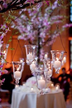 Tea candles hang from the branches, creating an ethereal look.