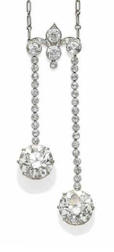 A DIAMOND, PLATINUM AND GOLD NECKLACE