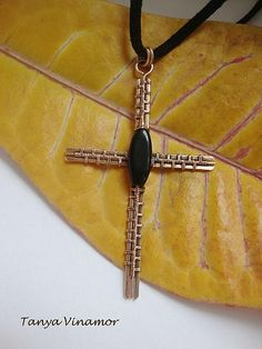 Bronze cross with agate