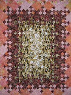 "Center of the Blooming Nine-Patch quilt, ""Wrapped in The Kiss"" by Tina Rathbone"