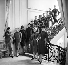 1953 Dior's cabine (13 models) are lined up on the staircase outside the Grand Salon before a highly anticipated trip to Japan