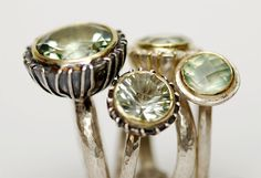 Adele Taylor - Oxidised silver, 18ct setting, green amethyst:  Adele picks up objects such as bits of broken car lights because of their textures & makes silver & 18ct gold casts to create pieces of jewellery or parts & small scale objects such as little vases for a single daisy.