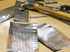 Punched Tin Frame Using Recycled Tin Cans -- this shows how to cut and flatten the cans, so they could be used for shed siding or even shingles or washboards