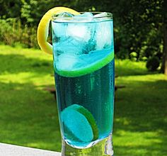 sex in the driveway | 2 oz. Vodka (Citrus, if you have it) 1 oz. Blue Curacao 1 oz. Peach Schnapps 4 oz. Sprite Lemon and/or Lime slices for garnish     Directions   Put a Lemon and/or a Lime slice in the bottom of a Collins glass.  Add the three spirits to an ice filled cocktail shaker.  Cover, shake well, and pour into your Collins glass.  Fill with Sprite, and garnish with a Lemon or Lime peel.