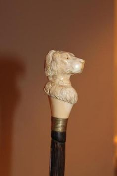 Walking cane with an ivory carved head of a dog
