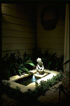 Nothing is more relaxing than the sound of water emanating from a fountain or pond. To accent this concrete figurine in the evening, one hidden halogen light was used to graceful bathe the area with soft glare free illumination. #houstonoutdoorlightingdesigner
