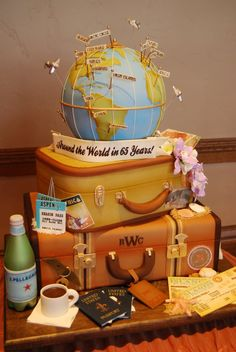"""Fun anniversary, wedding, adventure themed cake including a globe, passports, luggage, etc. - HD  """"Travelling the world---this is amazing! <3"""" OP"""