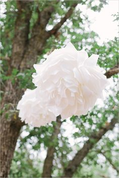 diy wax paper poofs ceremony decor--stand up to rain better than tissue paper