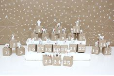 DIY Advent Calendar idea: Each craft box filled with a little white animal toy with a red Rudolph nose.