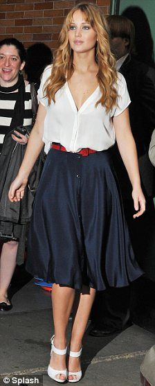 Jennifer Lawrence... red belt, white blouse and blue skirt