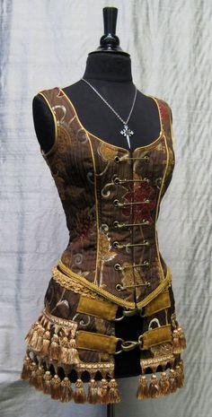 Corset-style bodice with tassel belt.