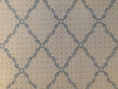 This is a wool remnant with a trellis pattern. www.thecarpetworkroom.com