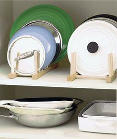 Lid racks neatly collect the tops to various pots and pans.