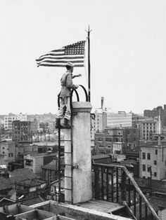 The American flag, first to fly over Tokyo since the Japanese surrender, is raised over the Nippon News building in downtown Tokyo on Sept. 5, 1945 by Lt. Bud Stapleton of Syracuse, N.Y.