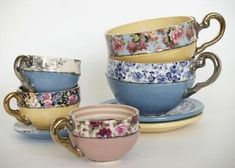 Ceramic tea cups would be beautiful hanging with a cup and saucer rack!