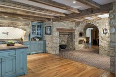 FARMHOUSE KITCHEN OR PERIOD-INSPIRED KITCHEN WITH COLONIAL BLUE CUSTOM CABINETRY, HARDWOOD FLOORS, STONE AND BRICK FLOORS AND EVEN A KITCHEN FIREPLACE. FROM EARLY AMERICAN STONE COLONIAL BY PERIOD ARCHITECTURE LTD., CLASSIC ARCHITECTURE OF PENNSYLVANIA'S DELAWARE VALLEY