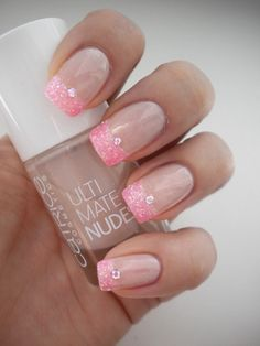 Glittery tips. Very pretty think I might try it but with white sparkle tips...
