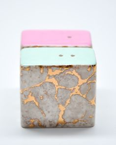 marbled salt and pepper shakers. i love the pastel hues on top.