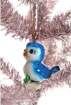 Porcelain bluebird ornament.