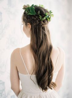wedding hair with a braid, photo by Jen Huang http://ruffledblog.com/intimate-wedding-at-the-foundry-in-brooklyn #weddinghair #brides #bridal