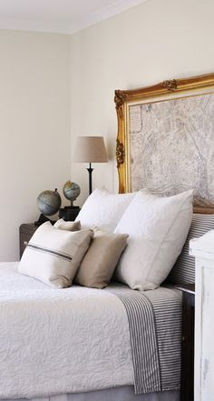 antique maps, white bedding, frame map, bedroom, cozy beds