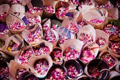 Super easy & cheap DIY project - confetti cones made out of pink newspaper! (No one keeps the confetti cones so why spend a fortune on them?) photo by Sarah Legge Photography