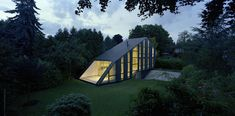 unusual shaped house with glass facades in german garden