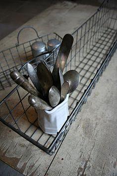 Antique flatware in metal basket