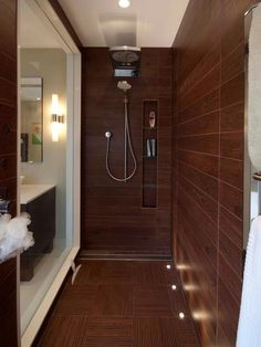 Walk-in Shower With Rainfall Showerhead. Love the wall tile...