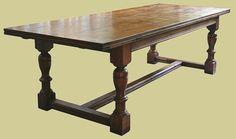 Extending oak reproduction antique diningtable 6-12 seater.