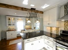 white new englander kitchen update with wood floors, SoPo Cottage featured on Remodelaholic
