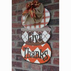 These pumpkins display the true meaning of thanksgiving and can be used for the whole fall season for years to come.  IDEAS FOR DISPLAY: * Front Door/Back Door * Over Garage * Porch/Deck * Party Decoration * Birthday Gift or Decoration * Hostess Gift * Housewarming Gift * Classroom Decoration * Teacher Gift Stacked Pumpkins Thanksgiving  Door Hanger Sign