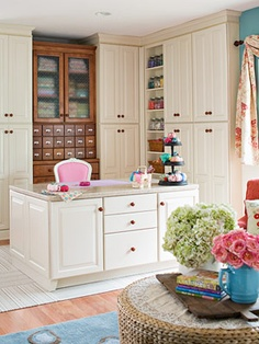 Cozy BHG sewing/craft room facing a sitting area