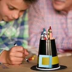 """Hats Off for Crayons: Fill these pilgrim hats with crayons, cover the kids' table with paper, and let your young guests draw all over the """"tablecloth."""""""
