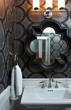 mirror and walpaper in washroom