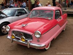 Red and pink never looked so good together.  Two-tone #1959 Nash Metro