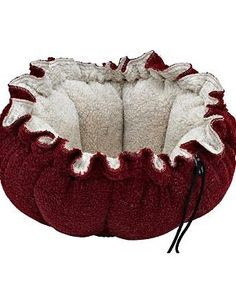 Give your pet a cozy place to nest or sprawl out with the Buttercup Pet Bed; available in four stylish designs.
