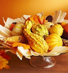 Bountiful centerpiece with corn husks. Details + more ideas: http://www.midwestliving.com/holidays/thanksgiving/easy-ideas-for-thanksgiving-decorating/?page=22,0
