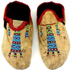 C. 1890's Northern Plains moccasins with beaded geometric pattern tops
