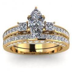 Marquise & Princess Diamond Engagement Ring Wedding Set - A Modern Style piece comes with this 14k Yellow Gold Marquise & Princess Diamond Engagement Ring Wedding Set placed in a Channel, Prong & Pave setting that features a White Marquise cut center stone with two White Princess cut accent stones on the shank & band. The Marquise & Princess engagement set comes with an SI2 in clarity with a G in color & the gem weight is equal to 2 carats. The diamonds are 100% natural. #unusualengagementrings